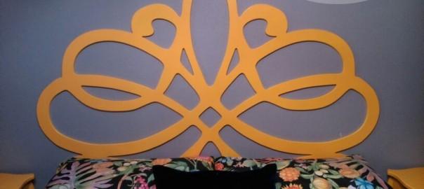 cabecero mariposa madera