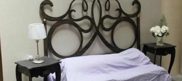 Dormitorio en forja y madera